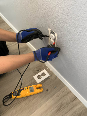 This picture shows an outlet and electrical repair in Parker