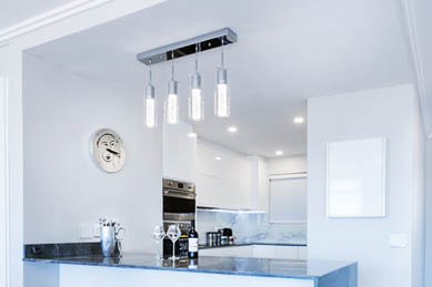 This picture shows track lighting installation in Parker. Lights are above the kitchen island.