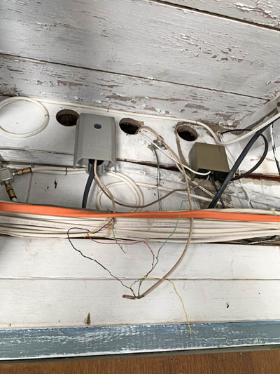 This picture shows a complete house wiring in Parker CO. The old wires are exposed.